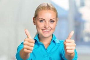 Happy young woman with thumbs up